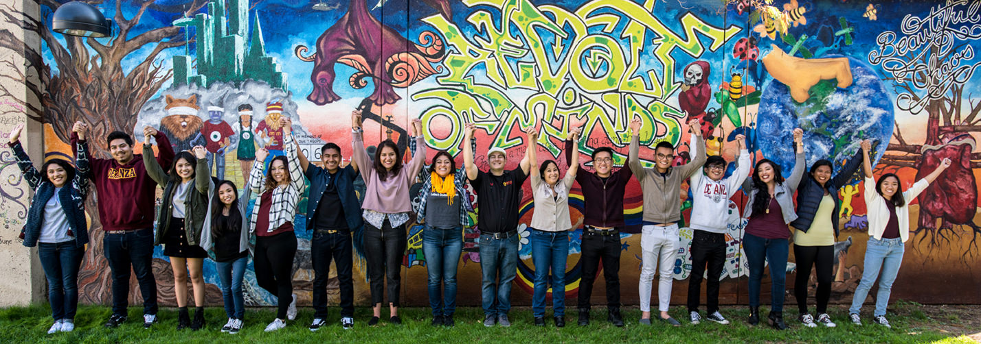 Students in front of a colorful mural